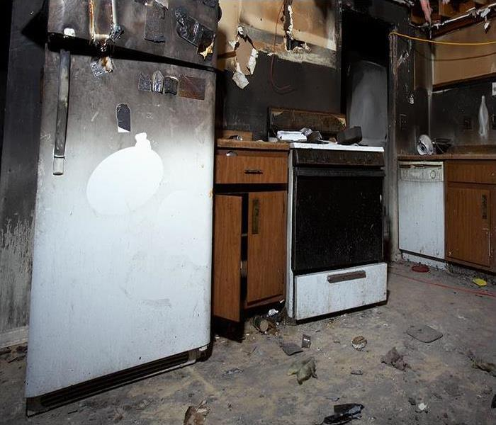 kitchen damaged by fire and soot damage