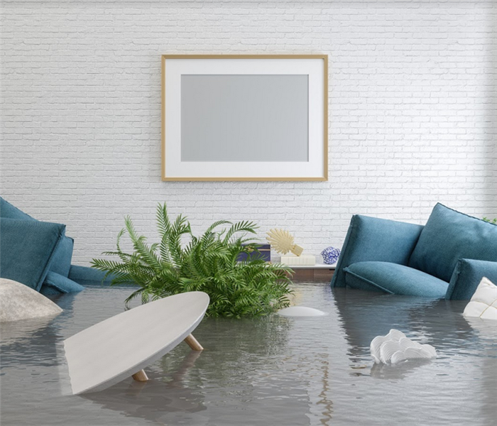 flooded interior of a living room with furniture floating