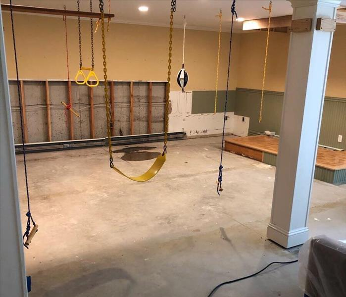 Gym in basement with water line cuts to prevent anymore water damage.