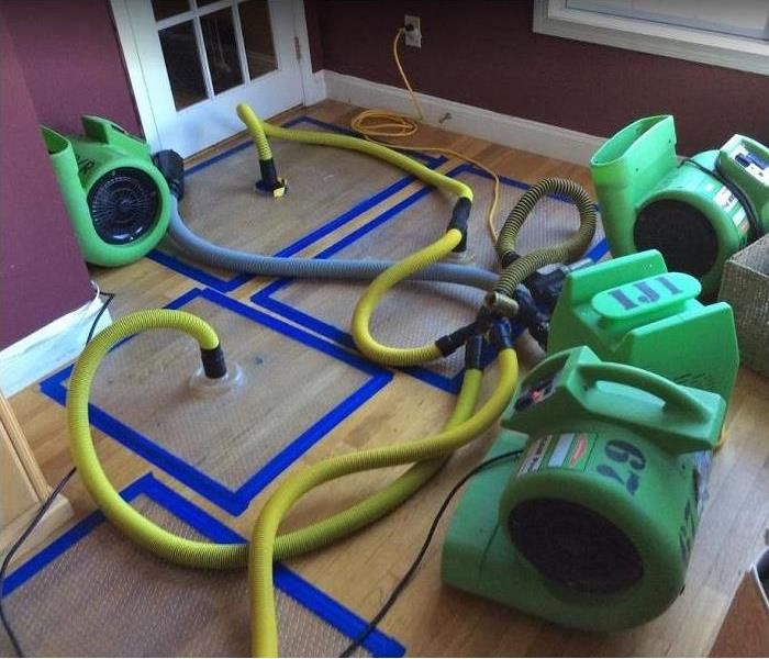 SERVPRO Drying Mats being used on water damaged hardwood floors