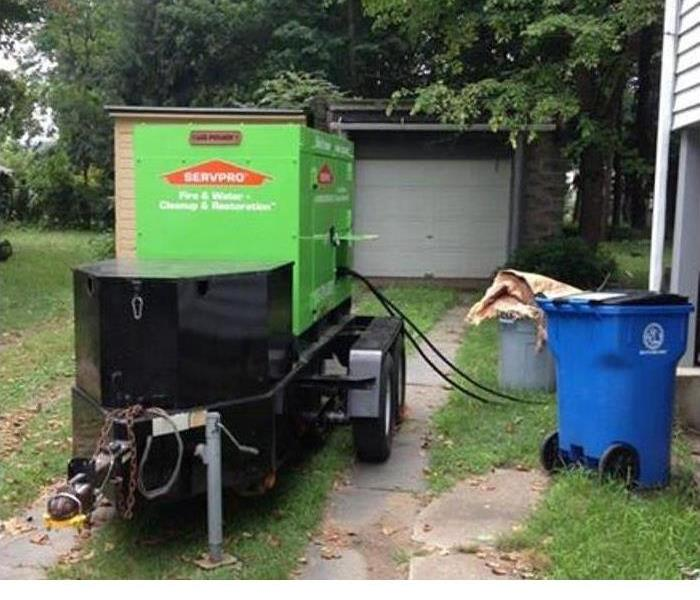 One of our diesel generators in a yard of a home working on storm damage